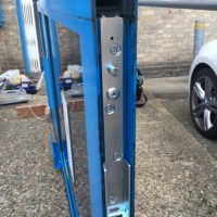 Commercial door repair, back loading arm