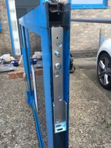 Commercial door repair, back loading arm
